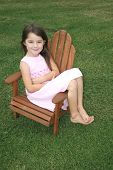 pic of lawn chair  - little girl sitting in a lawn chair - JPG