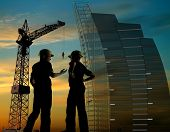 stock photo of construction crane  - Construction of a building on a background of the sky - JPG