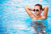 Beautiful Tanned Sexy Girl In Bikini Posing In Swimming Pool poster