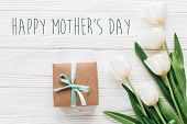 Happy Mothers Day Text Sign On Stylish Craft Present Box And Tulips On White Wooden Rustic Backgroun poster