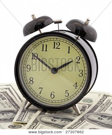 Alarm clock and dollars isolated on white background
