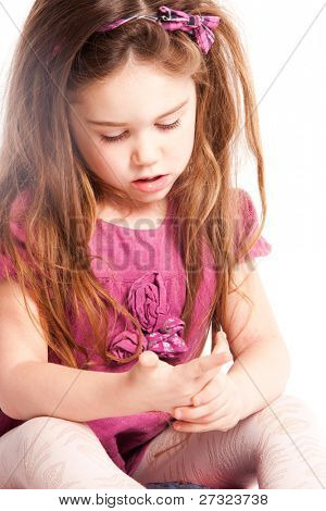 little girl counting on fingers, studio shot