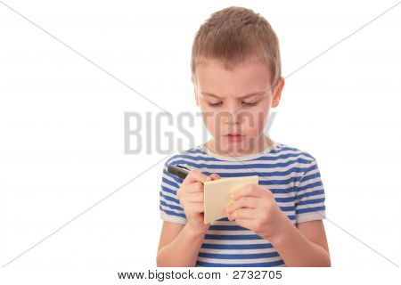Boy Writes On Sticker