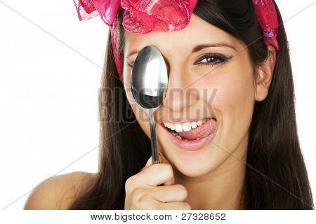 Pretty smilimg woman holding a sppon
