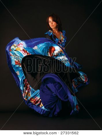 studio portrait of young attractive woman dancing
