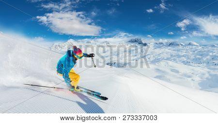 Alpine skier skiing downhill panoramic