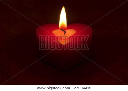 Romantic heart shaped candle and candlelight