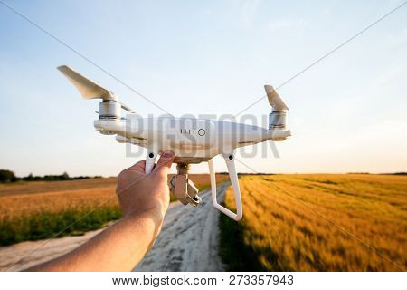 poster of drone quad copter on green corn field