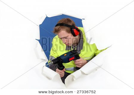 Man with drill and muffs
