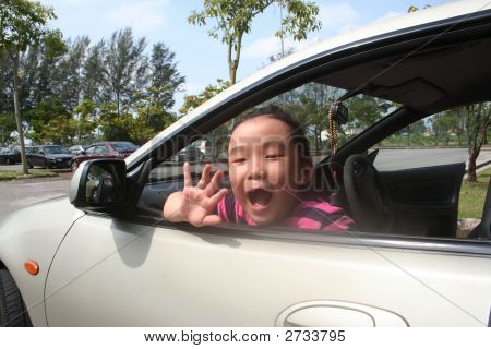 Girl Waving In The Car
