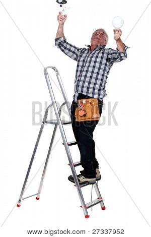 Electrocuted man changing a light bulb
