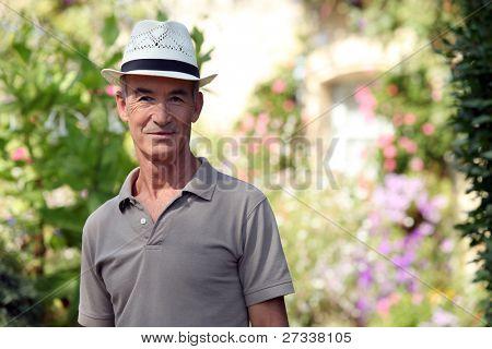 Senior citizen relaxing in his garden