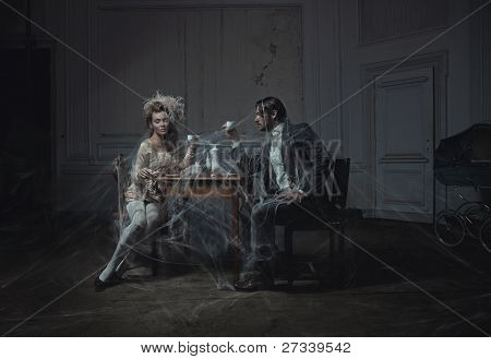 Young couple drinking coffee in an old castle