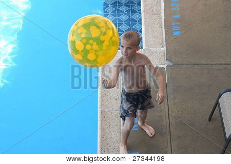Boy With Beach Ball By Pool
