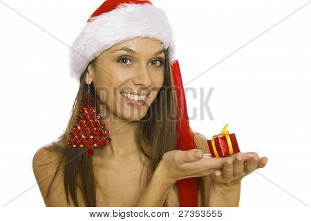 Santa woman holding gift wearing Santa hat