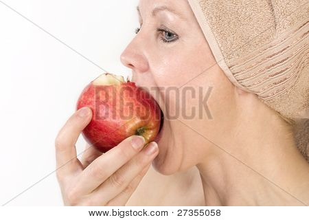 Adult Woman With A Towel On Her Head Biting An Apple.