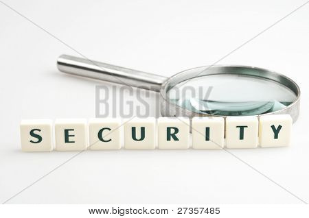 Security word and magnifying glass