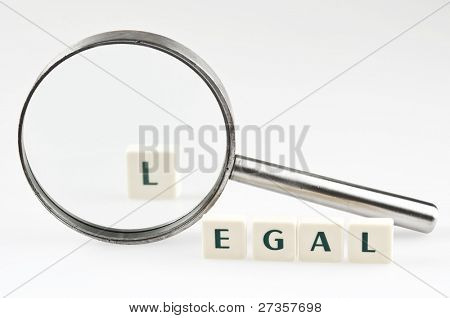 Legal word and magnifying glass