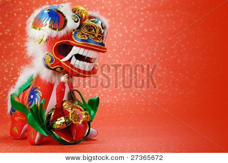 A traditional chinese dancing-lion on a festive background,the lion is believed to be able to dispel evil and bring good luck and prosperity in China.