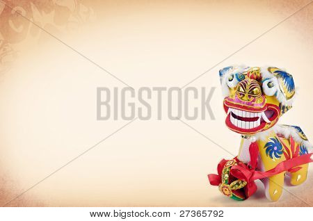 Traditional Chinese Dancing-Lion on Vintage Background.The lion is believed to be able to dispel evil and bring good luck and prosperity in China.