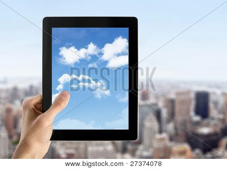 Hand Holds Tablet PC With Sky On Screen