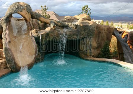 Custom Pool With Innovative Slide And Waterfall