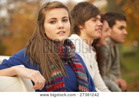 Close Up Of Group Of Teenage Friends In Autumn Park