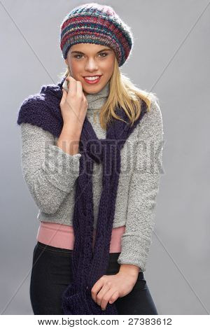 Teenage Girl Wearing Warm Winter Clothes In Studio