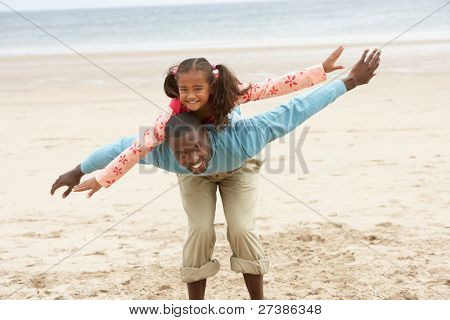 Father and daughter playing on beach