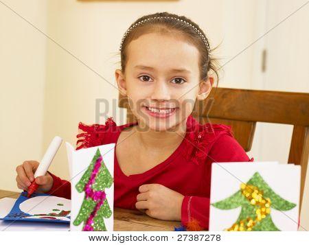 Junge gemischte Abstammung Kind machen Weihnachtskarten