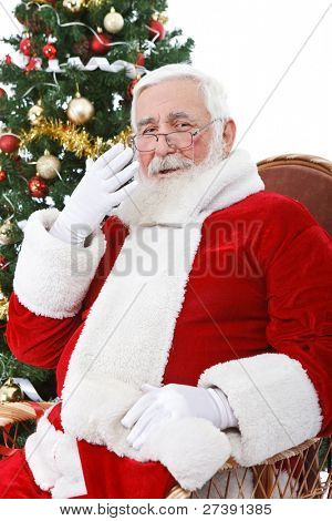Santa Claus yawning after  hard day, isolated on white background