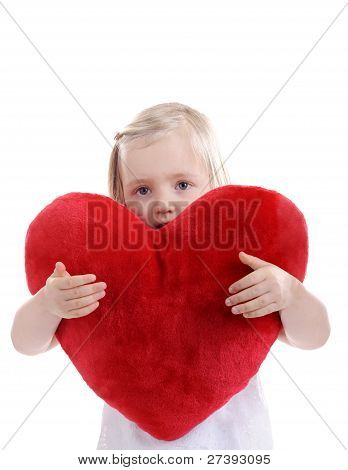 Little Blond Girl With Heart Shaped Pillow