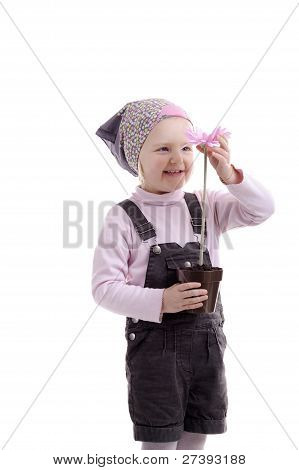 Little Girl With Headscarf & Pink Flower
