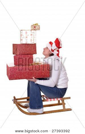 Young Woman With Christmas Presents On Sledge