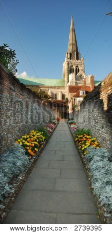 Pathway With Marigolds Leading To Chichester Cathedral