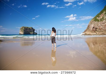 Woman At Seashore In Ballota Beach