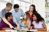 German Female Student With Group Of International Students An Teacher Indoor At Classroom Of Univers poster