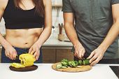 Healthy Lifestyle, Dieting, Proper Nutrition, Vegetarian Food, Paleo Diet. Sporty Couple Cooking Din poster