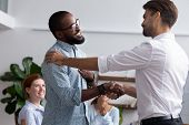 Company Boss Congratulating Handshaking With Successful Employee poster