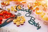 Candy Bar, Table With Colorful Sweets, Candies, Dessert. Buffet With Delicious Cupcakes, Cake Pops,  poster