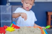 Cute Little Asian 2 - 3 Years Old Toddler Boy Playing With Kinetic Sand At Home ,fine Motor Skills D poster
