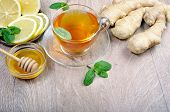 Honey, Ginger, Lemon And Cup Of Tea On The Wooden Table. Cold And Flu Remedy. Close Up. poster