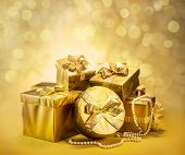 Golden gift boxes as a symbol of wishes and celebration. Golden blurred bokeh background. poster