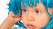 Funky Beauty. Small Child Wear Blue Wig Hair. Small Kid In Fancy Wig Hairstyle. Adorable Little Chil poster