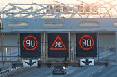 High-speed Highway With Traffic Cars And Electronic Interactive Speed Limit Signs And A Slippery Roa poster