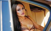 Sexy Womans Face In Luxury Car. Portrait Of Sexy Glamour Fashion Young Girl With Long Beautiful Hair poster