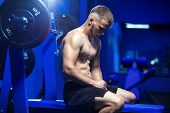 Young Pretty Man Tired After Weightlifting At Gym poster