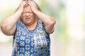 Senior plus size caucasian woman over isolated background suffering from headache desperate and stre poster