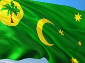 Flag Of Cocos Islands Waving In The Wind Against Deep Blue Sky. High Quality Fabric. poster