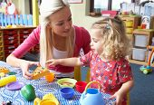 picture of nursery school child  - Young woman playing with girl - JPG
